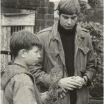 Photo of David Bradley holding one of the kestrels from the film Kes along with Richard from 1968